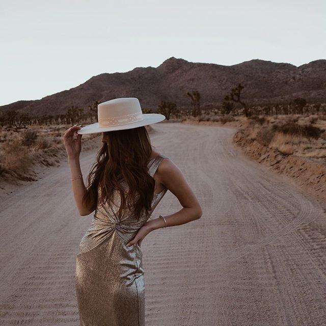 Desert glam @redeemingbeauty roams through #JoshuaTree in our #CALVINKLEIN party twist-detail evening dress.