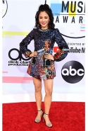 Constance Wu in No.21 and Stuart Weitzman heels