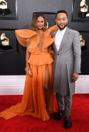 Chrissy Teigen in Yanina Couture and John Legend in Alexander McQueen
