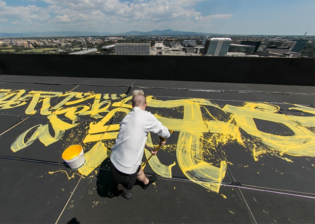 A silent interview with the artist behind the largest calligraffiti in Italy