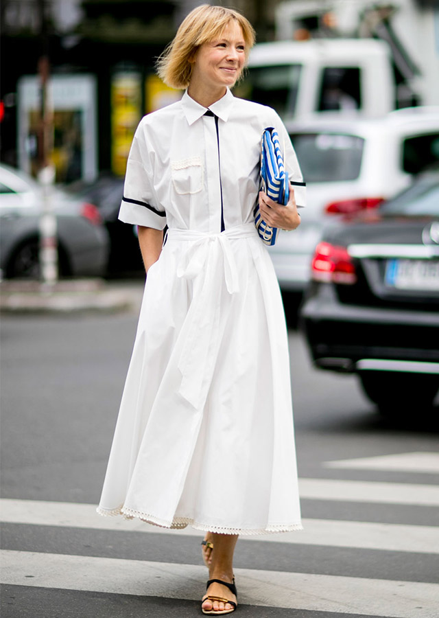 For an effortless vibe, go with a shirtdress, snazzy clutch and fuss-free sandals as per Vika Gazinskaya's look here.