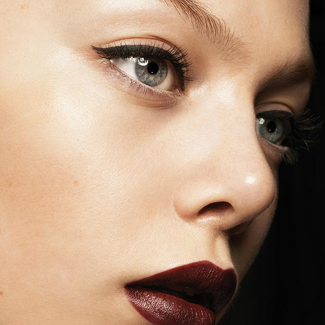 The Parisienne elegance is multiplied three-fold with a makeup look that is strong with the Eye Ink Matte Eyeliner in Blackest and matte lipstick in Black Cassis.