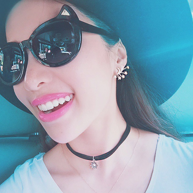 Beauty guru, Michelle Phan elevates a plain T-shirt with some mystical accessories