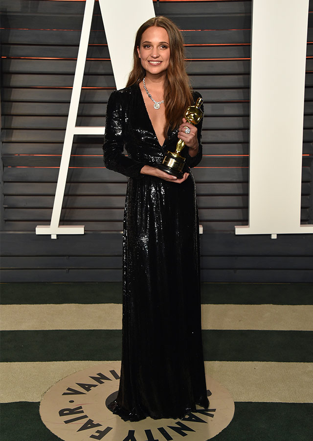 Alicia Vikander is all smiles as she cinches her award decked in Louis Vuitton (no surprises there!)