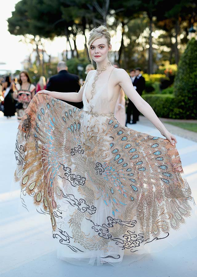 Elle Fanning was absolutely endearing in her spectacular Valentino gown with peacock embroidery