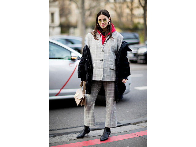 To add a street flair to your pantsuit—especially in a chilly weather—try layering a hoodie (in a bright red colour) under for a notice-me result. Opt for a pair of boots instead of your go-to sneakers for a dressier vibe.