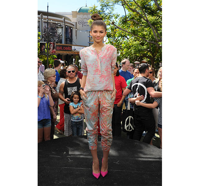 Zendaya shows us how loungewear can be pulled off for an event, in a printed blouse and matching silk joggers with Barbie pink pumps in tow.